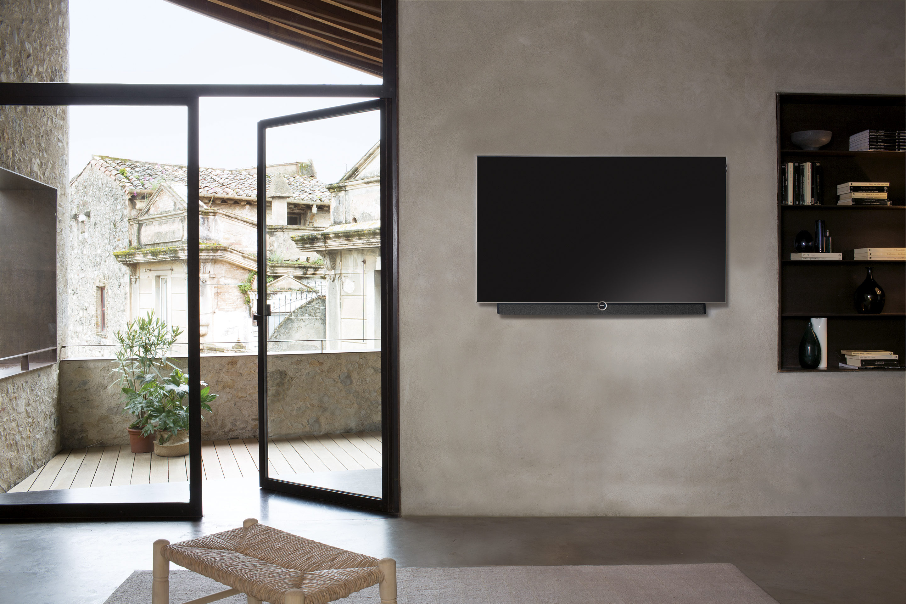 Loewe Bild 5.65 | Vogel's collaboration with motorized wall mount